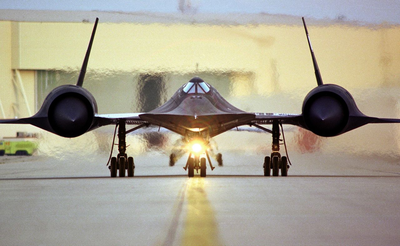 SR-71 Blackbird on the Runway, with heat waves in the background from the engine exhaust. (Source: Lockheed Martin)