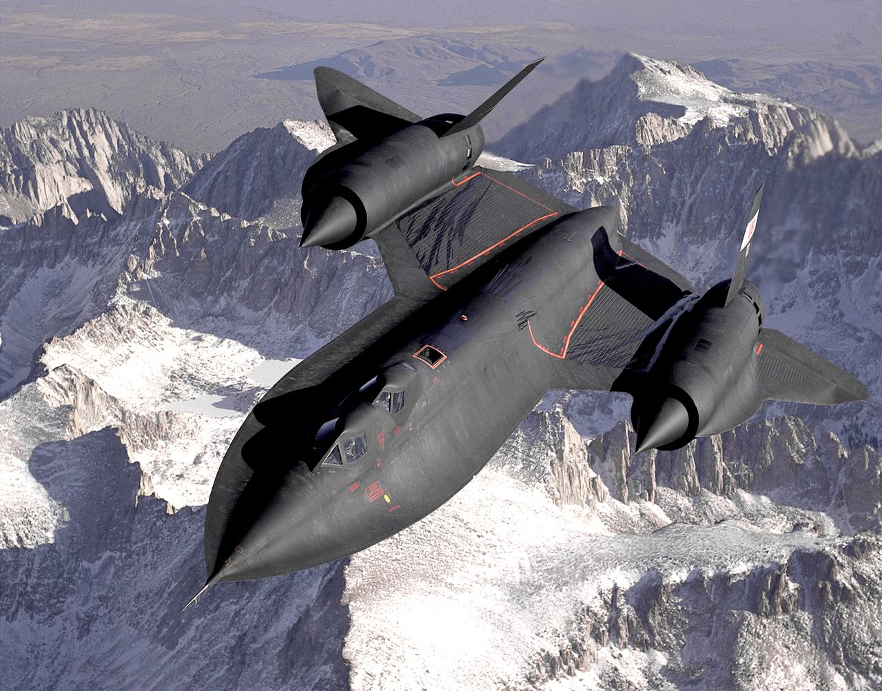 Lockheed SR-71 Blackbird in flight, note the streaks from fuel leaking out of the wings. (Source: NASA)